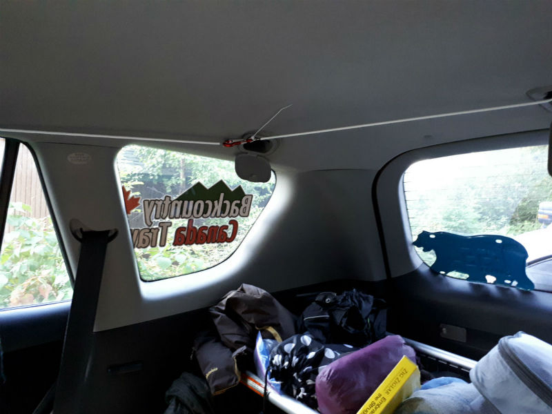 Attached wire to hang curtains in suv conversion