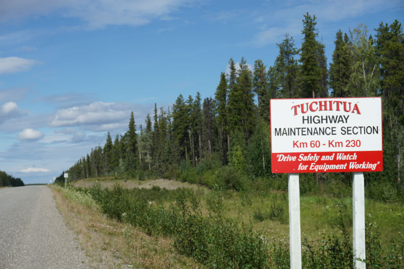 Tuchitua highway maintenance sign Yukon