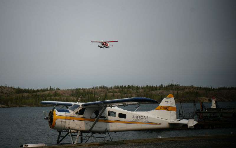 Watching the float planes in Old Town Yellowknife