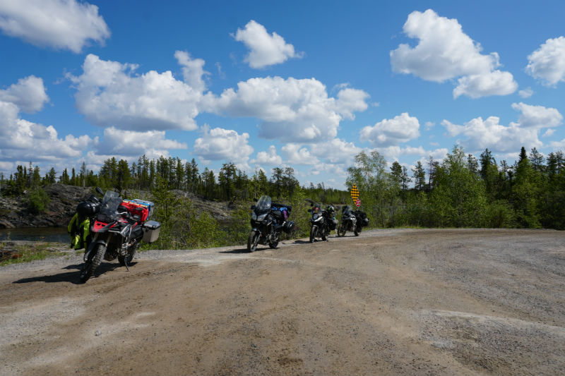 Bikers near Tibbitt Lake at the end of the Ingraham Trail