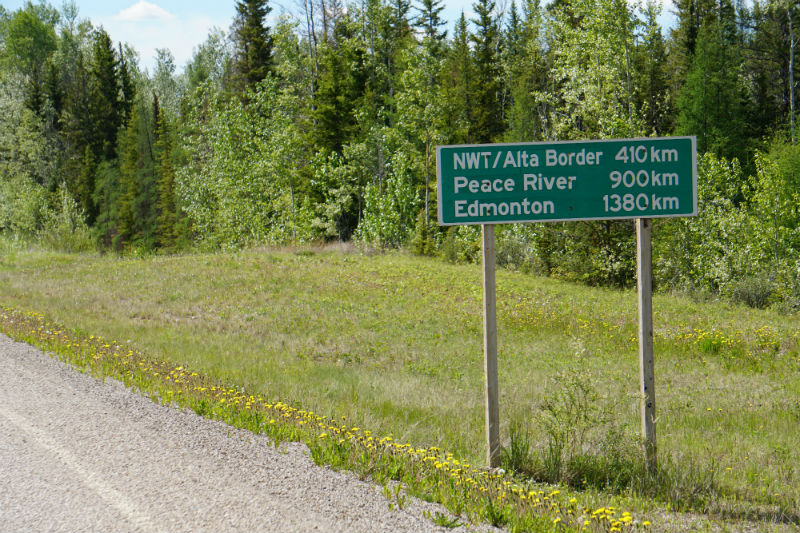 Distance road signs near Checkpoint, NWT